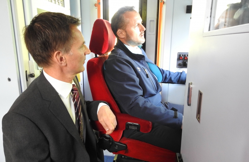 Jeremy Hunt MP in the front of the cab with SWR train driver Phil Cox